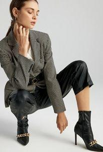 Zara chain trimmed heel boots blogger's favorite